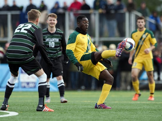 Vermont's Beranrd Yeboah (10) kicks the ball during the America East men's soccer championship game between the Binghamton Bearcats and the Vermont Catamounts at Virtue Field on Sunday afternoon November 15, 2015 in Burlington.