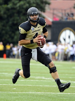 Vanderbilt quarterback Patton Robinette scrambles out of the pocket before throwing a touchdown Saturday. Sep 13, 2014.