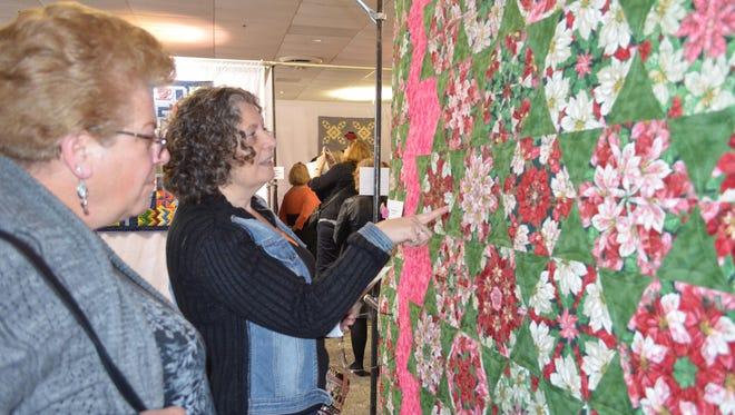Judith Horvath and Daniela Durham, both of Greenwich admire a quilt at the Garden Patch Quilt Club quilt show.