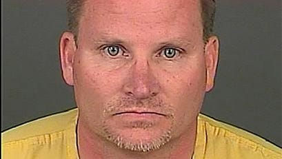 This file photo provided by the Denver Police Department shows Richard Kirk, 48. A preliminary hearing is scheduled for Kirk, who is charged with first-degree murder in the April 14 killing of his 44-year-old wife, Kristine Kirk, in their Denver home. Police officers arrived just after Kristine Kirk was shot in the head, about 15 minutes after she called 911. Police are investigating whether marijuana played a role in the killing.