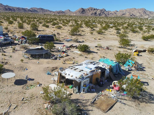 The parents of three children were arrested in Joshua Tree when the San Bernardino County Sheriff's Department found the family living in squalor in the open desert, March 1, 2018.