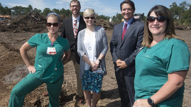 From left, Amanda Martin, Jeff Chandler, Michele Hobbs, Mark Stavos and Stephanie Weier from West Florida Healthcare attend the groundbreaking on the $10 million Perdido Bay Emergency Room on Tuesday, April 25, 2017.
