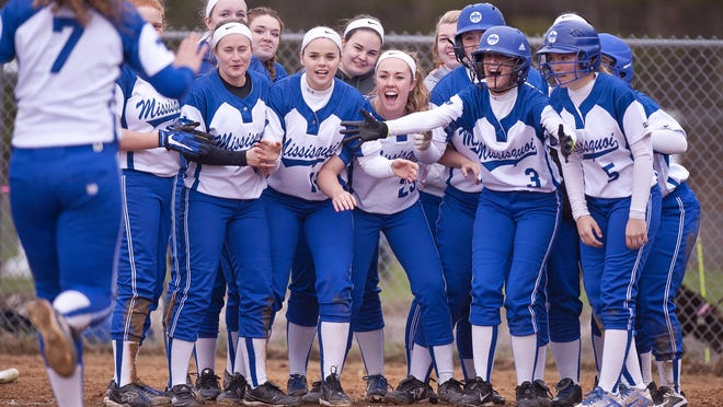 The Missisquoi Thunderbirds wait at home plate after a home run by Sarah Harvey (7) against Essex during Thursday's high school softball game in Essex.