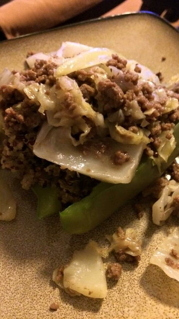 Smothered beef and cabbage over quinoa-stuffed peppers