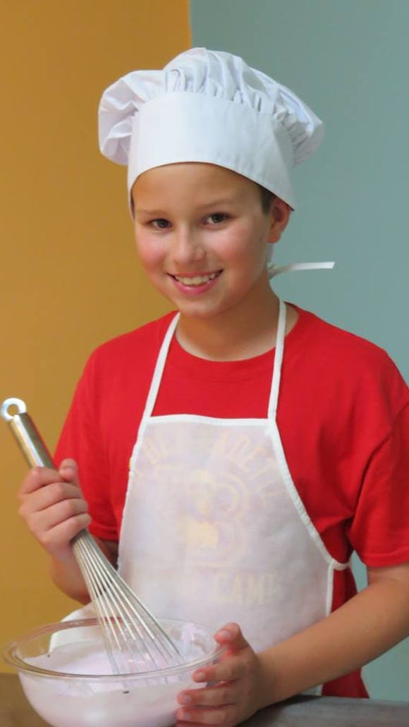 Brady Sins, 10, is pictured at Mix It Up in Houma. The son of owner April Sins has found a passion for cooking through the cooking classes.