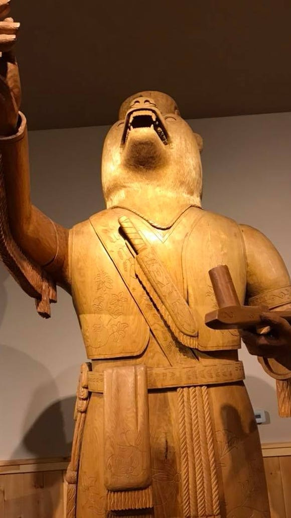 A carving of the Menominee ancestral bear dominates the tribal cultural museum. It was carved from the trunk of a butternut tree by James F. Frechette Jr.