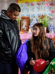Antonio Cuahua, 33, talks to his daughter Cecily Cuahua,