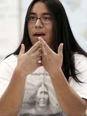 Madison West High School junior Gabriel Saiz, a member of the Ponca Tribe of Nebraska, participates in a discussion in Madison earlier this month. The students, and several other members of the school's Native American Student Association, are in favor of a recent school board decision which bans the wearing of any clothing that features Indian logos and mascots used by sports teams.