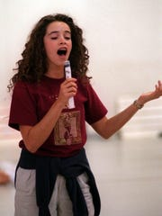 """In a 1996 PNJ file photo, """"Timeless"""" and """"rectify"""" star Abigail Spencer practices a number with the Pensacola Children's Chorus."""