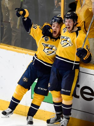 Predators left wing Viktor Arvidsson (38) Predators center Ryan Johansen (92) celebrate Arvidsson's overtime goal at Bridgestone Arena Monday May 9, 2016, in Nashville, Tenn.