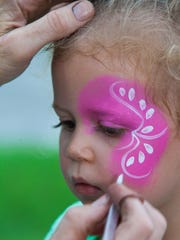 Stella McQuiddy gets her face painted at last year's