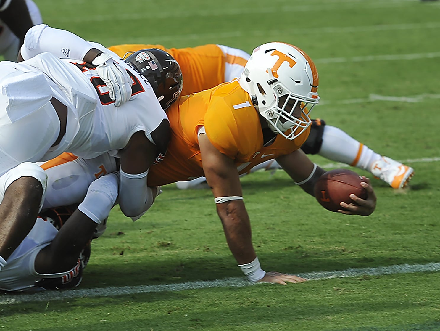 Tennessee running back Jalen Hurd (1) dives in for a touchdown past Bowling Green linebacker Austin Valdez (16) during the first half at Nissan Stadium in September.