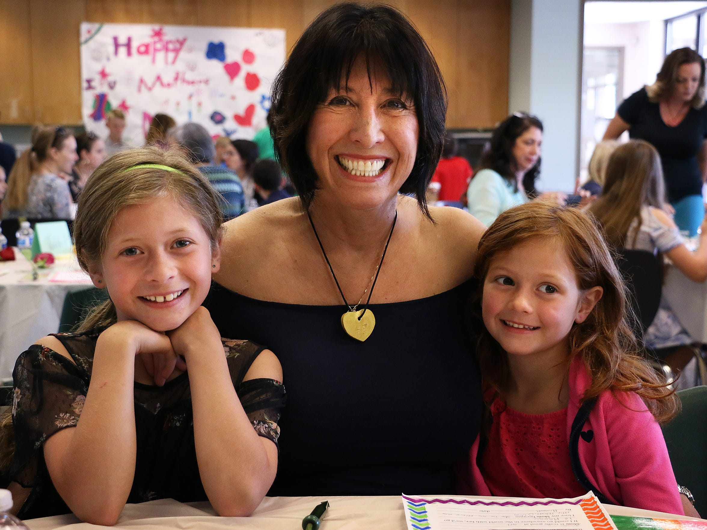 Cathy Taylor poses for portrait with her granddaughters Hannah, left, and Holly during a Mother's Day brunch at the Doral Academy in Reno on May 8, 2018. Taylor's daughter, Hannah and Holly's mom, died of cancer this past January.