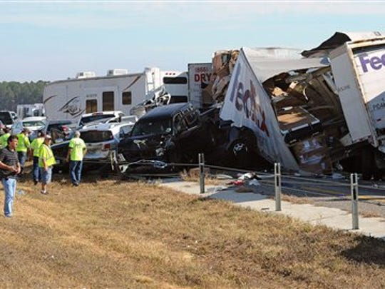 Cars and Trucks are piled on Interstate 10 in southeast Texas on Nov. 22, 2012, following a pileup of more than 140 vehicles.