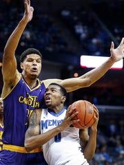 University of Memphis forward K.J. Lawson (right) drives to the basket against East Carolina University defender Andre Washington (left) Saturday at FedExForum.