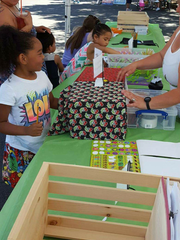 Kids work with Salem Saturday Market staff for the