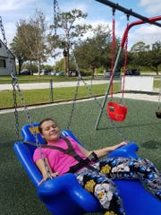 One of Katherine Capote's favorite things to do at Buddy Break is play on the swing.