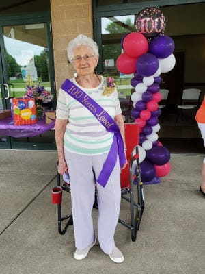 Martha Sandrus celebrated her 100th birthday a couple of days early when her nieces and nephews put on a drive-through party for the Alliance native.