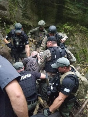 Shawn Christy was captured on Sept. 21, 2018 after a five-day manhunt in the Richland County area by several law enforcement agencies. He was sentenced last week to 20 years in prison for threatening to kill President Trump, making threatening communications, and weapons and other charges.