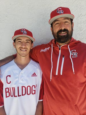 Centennial High School baseball's Chazz Vigil, left, and his coach/father Joe Vigil pose for a picture. Chazz, a senior, missed one last season with Joe after it was canceled due to the coronavirus pandemic.