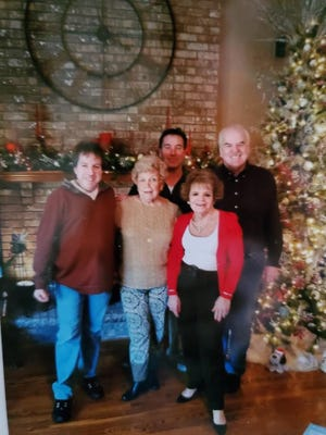 Christmas 2017 in Frances Heinle Dickson's living room with her son Chuck and daughter Vikki on either side of her in the front, and from left to right behind her, sons Jerry and Randy. Christmas was Fran's favorite holiday.