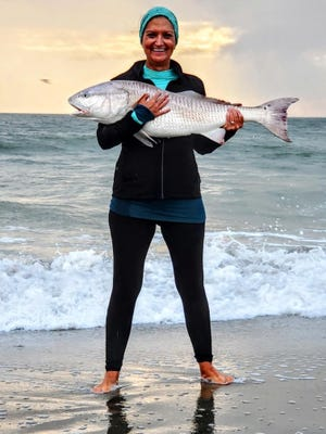 Christine Montville of Savannah caught this 42-inch bull redfish on Nov. 15 on Tybee Island.