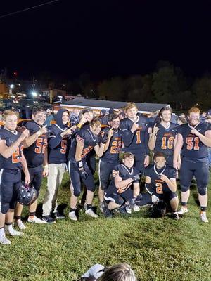 Jonesville football players celebrate winning the program's first Big 8 title since 2002. Photo: Lukas Cimbal
