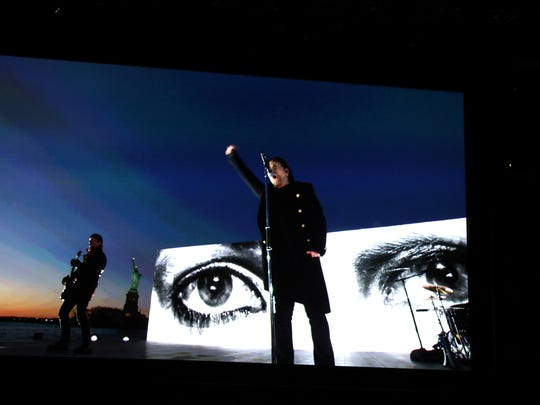 "U2 appears on screen as they perform ""Get Out of Your Own Way"" via satellite at the 60th annual Grammy Awards at Madison Square Garden on Sunday, Jan. 28, 2018, in New York. (Photo by Matt Sayles/Invision/AP)"