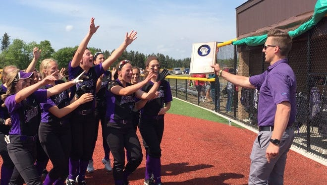 Members of the Mosinee softball team go to collect a WIAA Division 2 regional championship plaque after a 9-0 win over Antigo/White Lake on Friday.