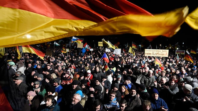 Demonstrators bear flags of several European countries during a rally of the group Patriotic Europeans against the Islamization of the West, or PEGIDA, in Dresden, Germany, on Monday, Jan. 12, 2015.