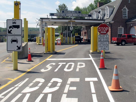 This Aug. 2, 2017 photo shows the U.S. border crossing post at the Canadian border between Vermont and Quebec, Canada, at Beecher Falls, Vt.