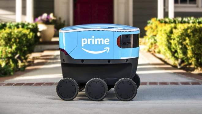 A self-driving delivery robot that Amazon is calling Scout.