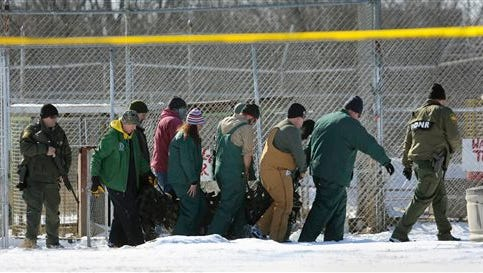 A tranquilized tiger is removed by state officials from the Tiger Ridge Exotics animal farm in Stony Ridge, Ohio, Wednesday. A Wood County Common Pleas judge later halted the transfer order of exotic animals from the Stony Ridge farm, ordering that they be returned to the property they were seized from earlier in the day.