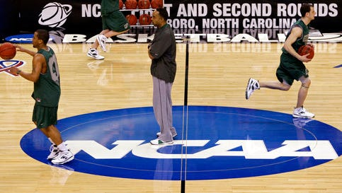 FILE - In this March 18, 2009, file photo, Binghamton coach Kevin Broadus, center, looks on during a basketball practice for a first round NCAA college basketball game against Duke, in Greensboro, N.C. For years, March brought the NCAA Tournament to basketball-crazed North Carolina like a fixture of spring. And South Carolina watched from afar, left out due to state-level politics that drew the ire of the NCAA. Those neighboring states are suddenly in reversed roles this weekend, with North Carolina _ host to more tournament games than any other state _ on the outside as South Carolina hosts its first NCAA games in 15 years.  (AP Photo/Steve Helber, File)