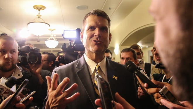 Michigan coach Jim Harbaugh speaks to the media Wednesday.