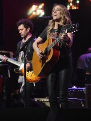 "Sheryl Crow's forthcoming album features a duet of her song ""Redemption Day"" with Johnny Cash."