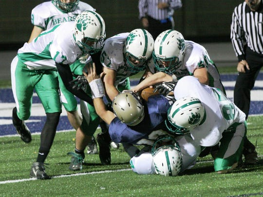 The Margaretta defense makes a goal-line stand, tackling St. Mary Central Catholic quarterback Trevor Fitzthum in a game last season.