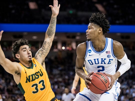 Duke forward Cam Reddish (2) makes a move against North Dakota State guard Jordan Horn (33) during the first half of a first-round game in the NCAA men's college basketball tournament Friday, March 22, 2019, in Columbia, S.C. (AP Photo/Sean Rayford)
