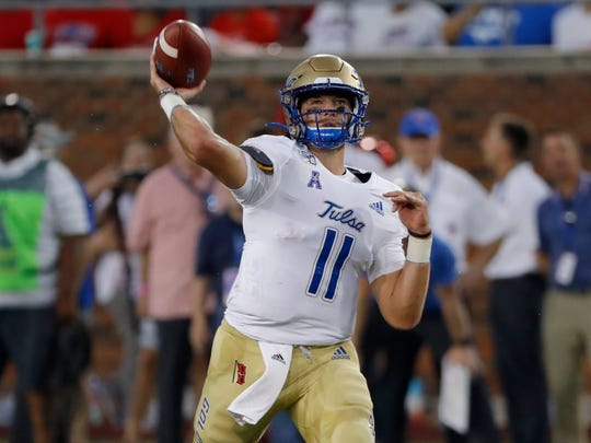 Tulsa quarterback Zach Smith throws a pass during the first half of an NCAA college football game against SMU, Saturday, Oct. 5, 2019, in Dallas, Texas. (AP Photo/Roger Steinman)