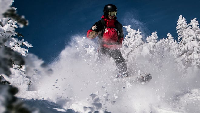 Ross Lodato, ski patroller at Stowe Mountain Resort, pounds the powder off trail at the top of Spruce Peak Friday morning, Feb. 17, 2017. Behind him, fellow ski patroller Steve Yates watches from above as Risk Manager Karen Wagner, head of patrol, watches from below. The three-person team is the standard for safety in glades, the logic being if one gets hurt, one stays with them and the goes for help.