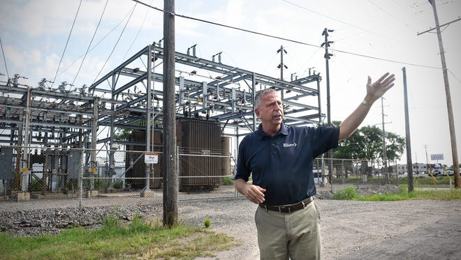 St. Cloud Mayor Dave Kleis talks about redevelopment plans for a land surrounding an electric substation near Cooper Avenue and Minnesota Highway 23 during a bus tour Tuesday, Aug. 1, in St. Cloud.