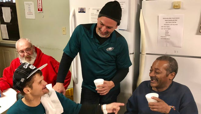 Todd Thomas (left), Brian Newman (center) and Curtis Fagginn (right) talk to each other during a Super Bowl party the evening of Sunday, Feb. 4 at the Chambersburg Cold Weather Drop-in Shelter on West Loudon Street. Fagginn and Thomas are currently staying in the shelter, and Newman is a member of the board and a volunteer at the shelter.