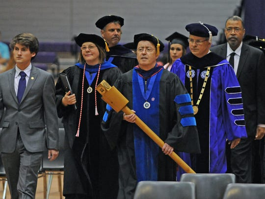Leading the procession at Northwestern State University spring commencement are (in front from left) Garrett Pierce, former Student Government Association president; Lisa Abney, provost and vice president for academic and student affairs; Massimo Bezoari, president of the NSU Faculty Senate; and President Jim Henderson.