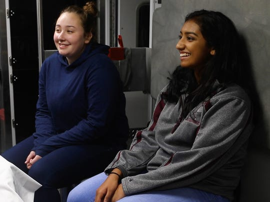 University of Delaware students Kathryn Dywer, right, and Shreya Kolipaka are participants of a program between UD and local fire stations that help students with interests in the medical field a chance to get some hands-on experience.
