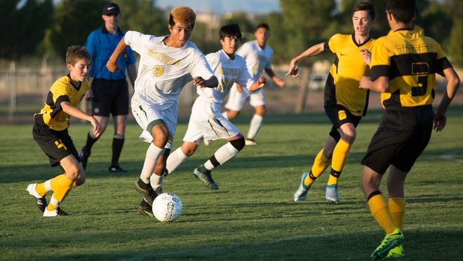 Mayfield midfielder Angle Soto (9) goes for the ball during Tuesday's game against Alamogordo High School.