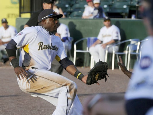 York Revolution first baseman Telvin Nash stops before he heads down the stairs of the Revolution dugout as he attempts to catch a foul ball during a game against Sugar Land.