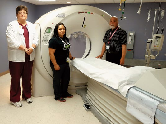 Courtesy Photo   Mimbres Memorial Hospital Radiology department staff Gloria Stout, AART RT, Dianira Alvarado AART RT (center)  and Director Gene Vogeli, with the new low dose, high image quality Toshiba CT scanner recently installed in Deming.