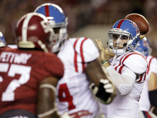 Mississippi quarterback Chad Kelly, right, passes the ball against Alabama during first half of Saturday night's game in Tuscaloosa, Ala. No. 15 Ole Miss faced No. 2 Alabama on national television. Kelly played a portion of his high school football career at Red Lion, where he was dismissed from the team. After attending the University of Clemson and then junior college, he's been the starting signal caller for the Rebels this year.