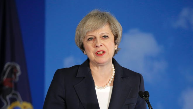 """UK Prime Minister Theresa May speaks during the Congress of Tomorrow, Republican Member Retreat, at the Loews Philadelphia Hotel on January 26, 2017 in Philadelphia, Pennsylvania.                    British Prime Minister Theresa May said that allies of the United States must """"step up"""" and play their role in global security, echoing a warning by US President Donald Trump. / AFP / Dominick Reuter        (Photo credit should read DOMINICK REUTER/AFP/Getty Images)"""