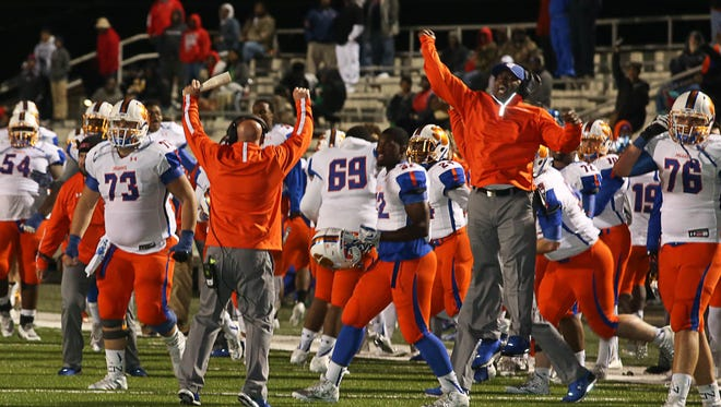Madison Central sidelines celebrate a 4th down and goal stop, forcing a turnover on downs. Madison Central upset South Panola 14-8 on Friday in the first round of the 6A playoffs.